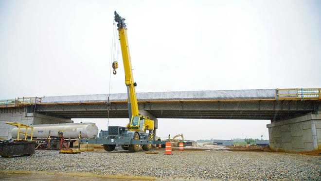 Construction equipment is parked near the Bunker Hill Road overpass of the U.S. 301 tollway, which is under construction.