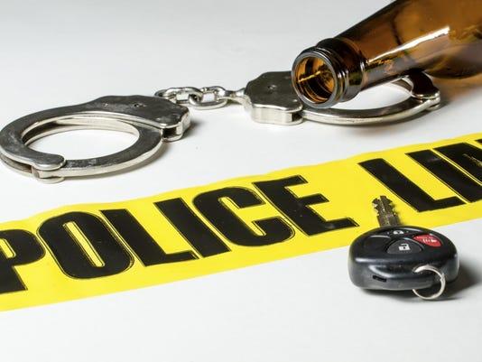 PoliceDWIHandcuffsDrink181541526