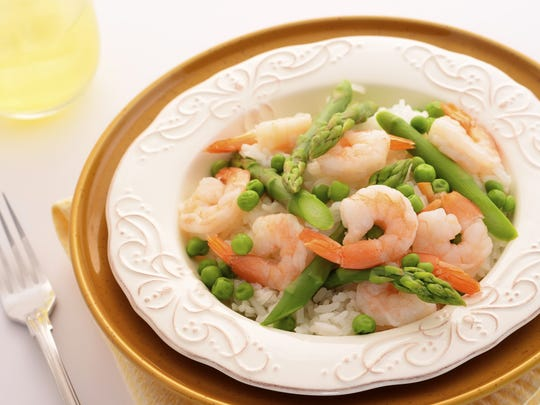 Shrimp and asparagus pair well together in a stir-fry.
