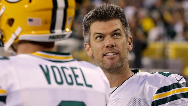 Green Bay Packers kicker Mason Crosby waits with punter Justin Vogel during   their game against Chicago on Sept. 28 at Lambeau Field.