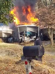 Police said a boat and trailer caught fire late Sunday morning outside a home in Airmont.