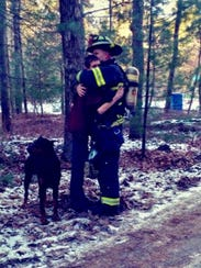 Tabernacle firefighter Jason Penwell (right) hugs his