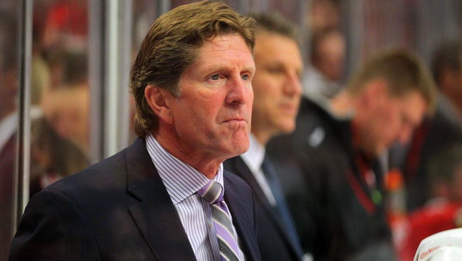 Detroit Red Wings coach Mike Babcock workds against the Chicago Blackhawks.