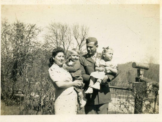 One of the photos of Army Pvt. Harry V. Nourse kept in a small leather wallet that was found among recycled waste at Garten Services. This one is presumed to be of him and his wife and their two children.