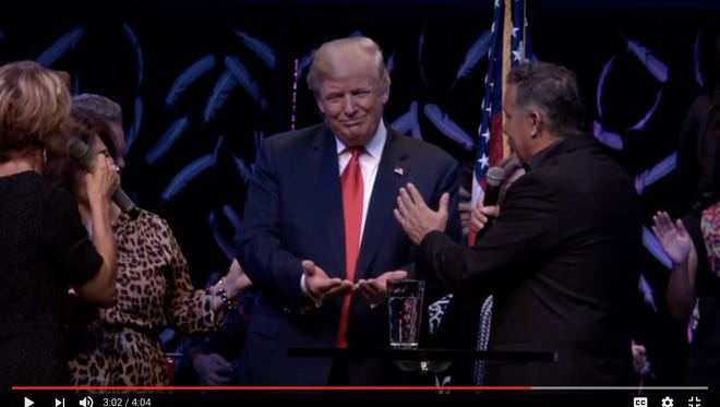 Donald Trump receives prayer  at the International Church of Las Vegas in an Oct. 30 video.