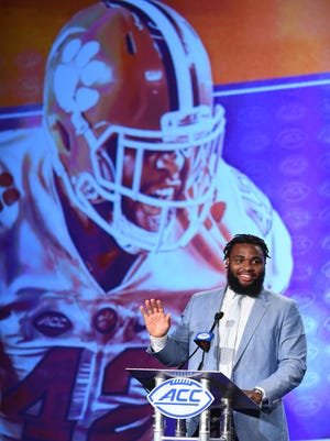 Clemson's Christian Wilkins waves before answering questions during the 2017 ACC Kickoff in Charlotte on Thursday, July 13, 2017.