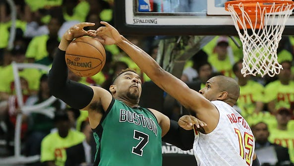 Atlanta Hawks' Al Horford, right, blocks a shot by