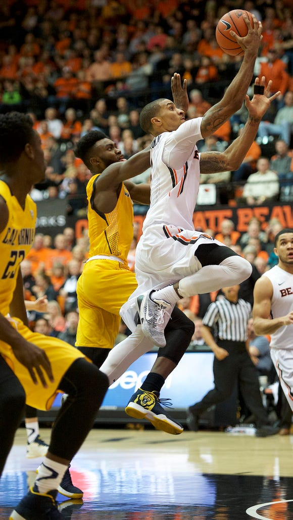 Jan 9, 2016; Corvallis, OR, USA; Oregon State guard Gary Payton II (C) shoots the ball past California forward Jaylen Brown (0) at Gill Coliseum.
