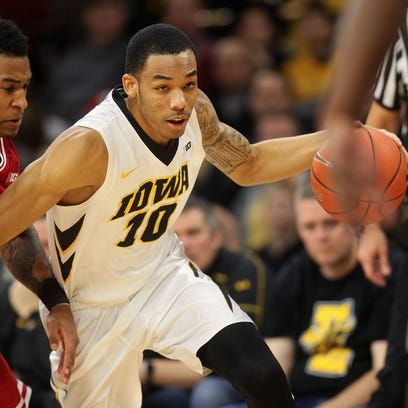 Iowa's Christian Williams drives to the hoop against