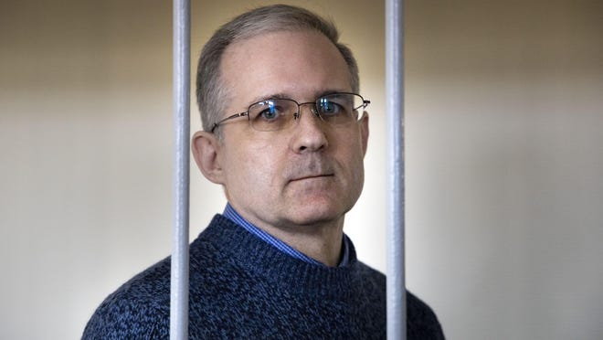 In this Aug. 23, 2019, file photo, Paul Whelan, a former U.S. marine who was arrested for alleged spying in Moscow on Dec. 28, 2018, stands in a cage as he waits for a hearing in a court room in Moscow, Russia. The Moscow City Court on Monday June 15, 2020, convicted Paul Whelan on charges of espionage and sentenced him to 16 years in maximum security prison colony. Whelan has insisted on his innocence, saying he was set up.