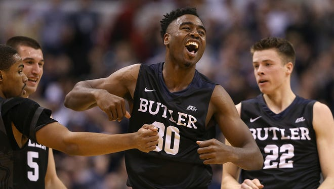 Butler Bulldogs forward Kelan Martin (30) cheers over their continued lead during first half action of the Crossroads Classic between Butler and Indiana at Bankers Life Fieldhouse in Indianapolis, Saturday, Dec. 17, 2016.