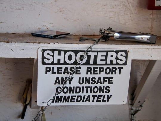 A safety sign is displayed at the Sidney Paul Gordon Shooting Range.