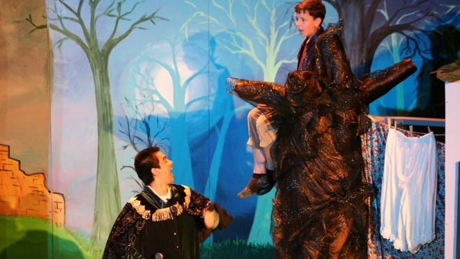 The handsome prince (Tristen Menzies) has Jack (Ben Crawford) up a tree.