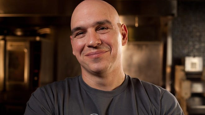 """Chef Michael Symon, co-host of ABC's """"The Chew,"""" is also a full-on restauratuer. He opens B. Spot in Indianapolis the weekend of July 24, 2015."""