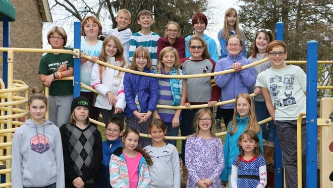 Shown are members of the Hamilton-Gibson's Choir in grades 2-4 and the Children's Concert Choir in grades 5-8 will perform Friday at the Dickens of a Concert.