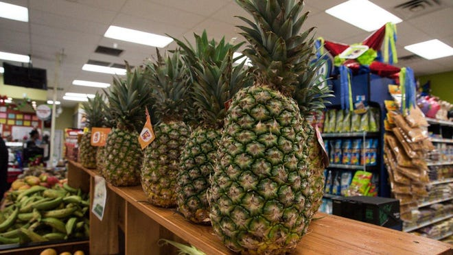 Pineapples preen at Tapatia Supermarket in West Palm's Westgate neighborhood.