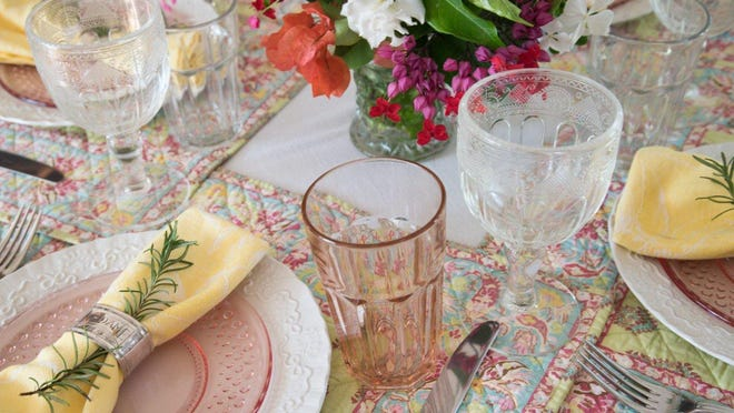 Easter brunch at home: Our table is set with beloved family pieces, like my grandmother's Fostoria vase and vintage pink L.E. Smith glass plates, and fresh greenery from the backyard.