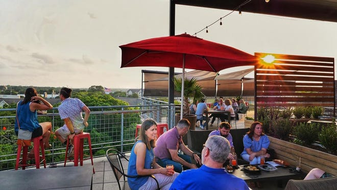 Patrons enjoy Urban Rooftop on Memorial Day weekend. The bar was closed for 10 weeks, along with other bars and restaurants across Texas, to prevent spread of the coronavirus.