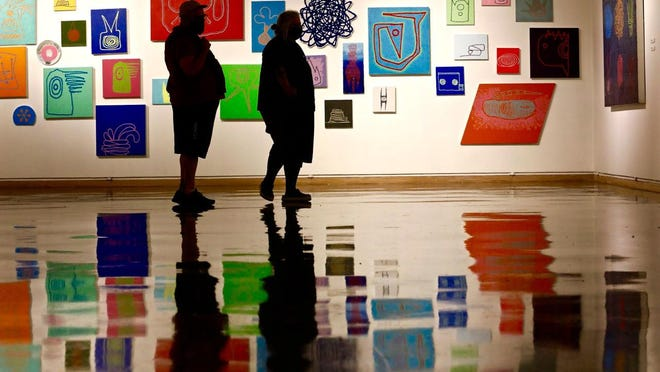 William New, left, and Elizabeth Carpenter, both of Beloit, Wisconsin, during a visit to the Rockford Art Museum on Tuesday.