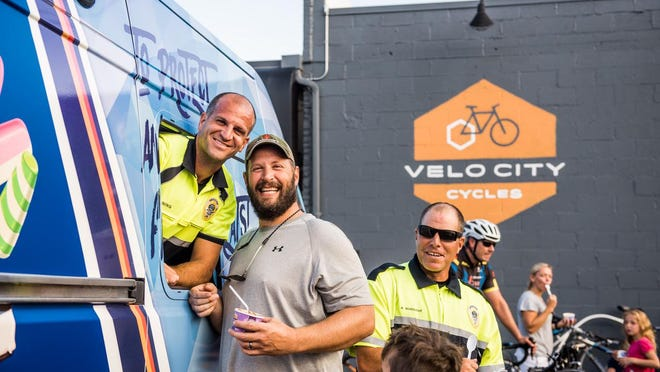 Holland Police officers will hand out ice cream for this year's Ice Cream Bike Ride, Wednesday, July 22.