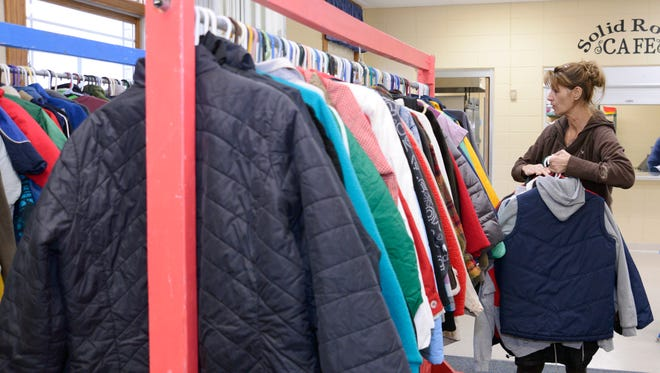 Volunteer Sue Anderson, of Manitowoc, sorts donated items for the Salvation Army Coats for Kids drive in 2015.