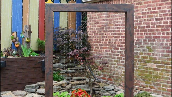 A water curtain is a cool way to increase interest in the sights and sounds of your garden.