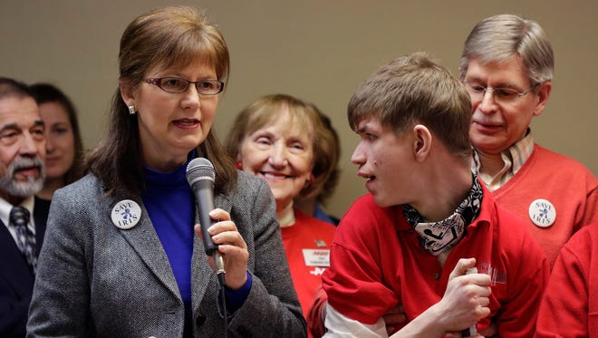 Harriet Redman (left) of Appleton talks about her son Phillip's complex needs and her concerns about proposed changes in Family Care and IRIS programs during a gathering at the Brillion Community Center Wednesday. The gathering preceded the Joint Finance Committee public hearing held at Brillion High School.