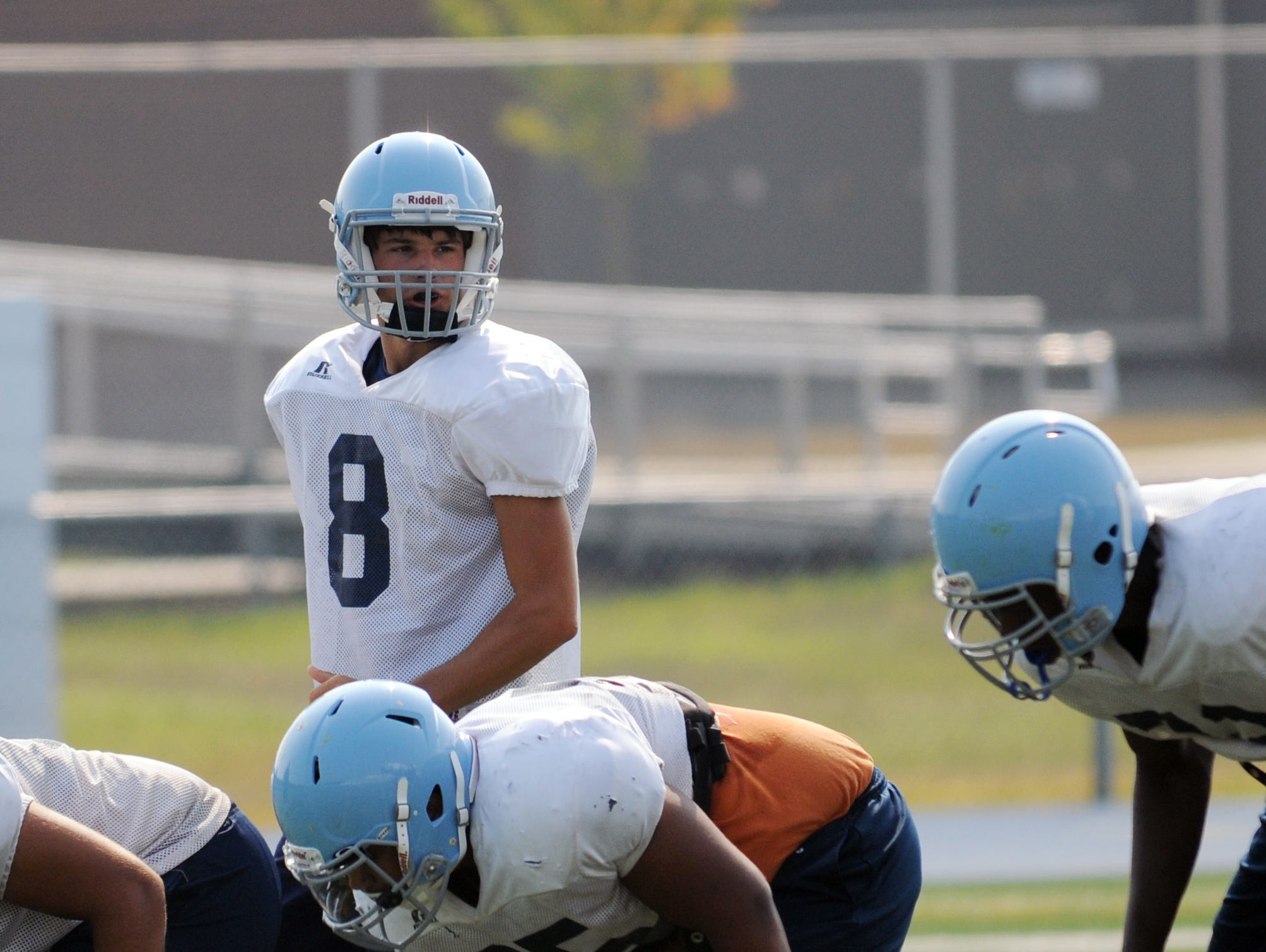Cape Henlopen junior quarterback Dillon Adams (8) takes first-team snaps during practice Friday, Sept. 4.