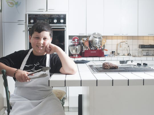 Chef Daniel Marcus, age 12,  poses for a photo after cooking beef ribs on a grill at his home in Cherry Hill. Marcus was featured on the Food Network Kids BBQ Championship show Monday night.
