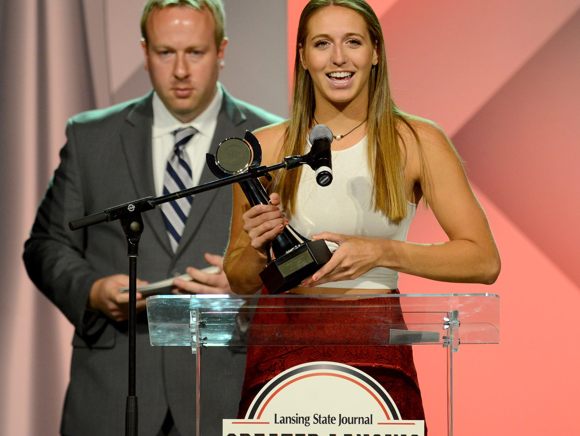 Angela Palmer, of Okemos, accepts the award for Girls Lacrosse Player of the Year at the Lansing State Journal's Greater Lansing Sports Awards Show show Tuesday, June 7, 2016 at the Lansing Center.