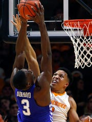 FILE - In this Jan. 24, 2017, file photo, Kentucky forward Edrice Adebayo (3) goes for a dunk as he's defended by Tennessee forward Grant Williams (2) during the first half of an NCAA college basketball game, in Knoxville, Tenn. Williams wasn't quite satisfied with a freshman season in which he dramatically outperformed his recruiting ranking.(AP Photo/Wade Payne, File)