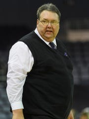 University of Evansville Head Coach Marty Simmons watches his team play the Bradley Braves at the Ford Center in Evansville, Ind., Saturday, Jan. 6, 2018. The Purple Aces defeated the Braves, 68-44.