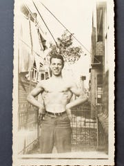 A 17-year-old Frank Spellman poses shortly after taking up weightlifting in 1939 outside his oldest sister's house in Philadelphia. Photo courtesy of Frank Spellman.