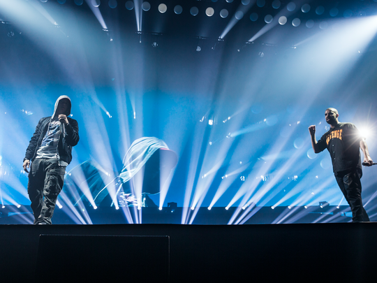 Eminem (left) and Drake onstage at Detroit's Joe Louis Arena on Tuesday night
