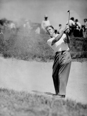 Sam Byrd, former baseball player who turned golf pro, blasts out of a sand trap on the 18th hole at Beverly Country Club, Chicago, Ill., Aug. 19, 1943.