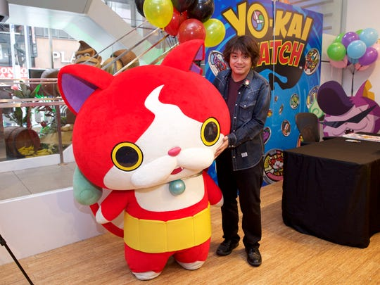 LEVEL-5 founder and CEO Akihiro Hino poses with Yo-Kai