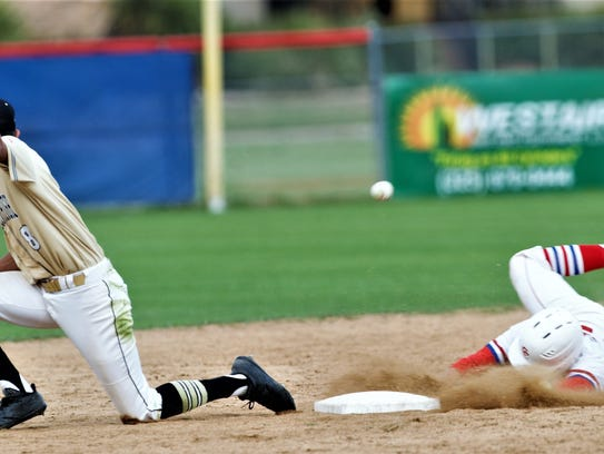 Cooper's Andrew Benson, right, slides safely into second
