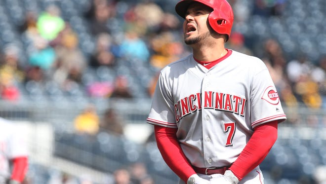 Reds third baseman Eugenio Suarez (7) reacts after being hit on the hand with a pitch against the Pittsburgh Pirates during the fourth inning at PNC Park on Sunday, April 8, 2018. Suarez would leave the game.
