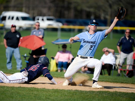 Eastern's Jack Winsett (left) slides back into first base as Shawnee's Nate Liedtka catches the ball last season. Both teams are in this week's South Jersey Mean 15 rankings.