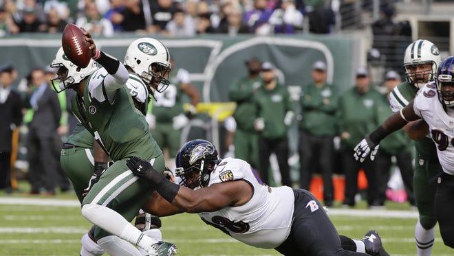 Baltimore Ravens nose tackle Brandon Williams sacks Jets quarterback Geno Smith during the first quarter of Sunday's game.