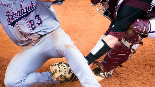 Farragut's Myles McFerran is tagged out by Bearden's Ross McKenry on Monday.