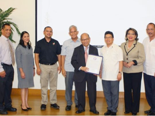 The 33rd Guam Legislature also presented Dr. Bernardo M. Villegas with a legislative certificate in recognition of his accomplishments and to commemorate his visit to Guam. In photo from left to right are Senator Frank Aguon, Senator Mary Camacho Torres, Senator Dennis Rodriguez Jr., UOG President Robert Underwood, Dr. Bernardo M. Villegas, Consul General Marcianor R. de Borja, Senator Nerissa Bretania Underwood, Ph.D., and Vice Speaker Benjamin Cruz.