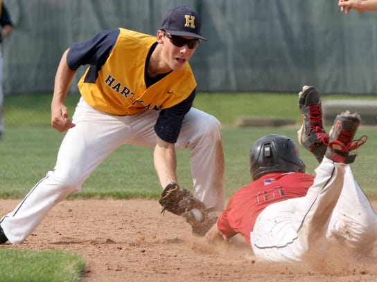 Hartland's Hunter DeLanoy tags out Athens runner Nick