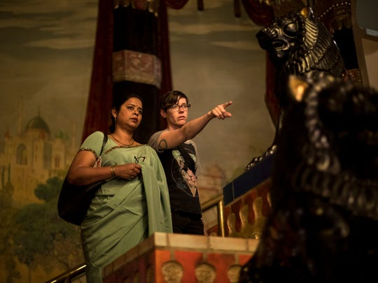 Lois Bielefeld (right) points to a spot for fellow artist Nirmal Raja. They're collaborating in a project that has Bielefeld photographing Raja wearing her traditional saris  in many Milwaukee locations.