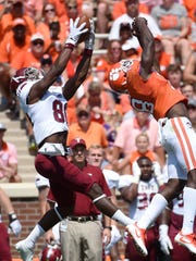 Troy wide receiver Deondre Douglas (80) makes a catch as Clemson safety Jadar Johnson (18) defends during the first half on an NCAA college football game on Saturday, Sept. 10, 2016, in Clemson, S.C. (AP Photo/Rainier Ehrhardt)