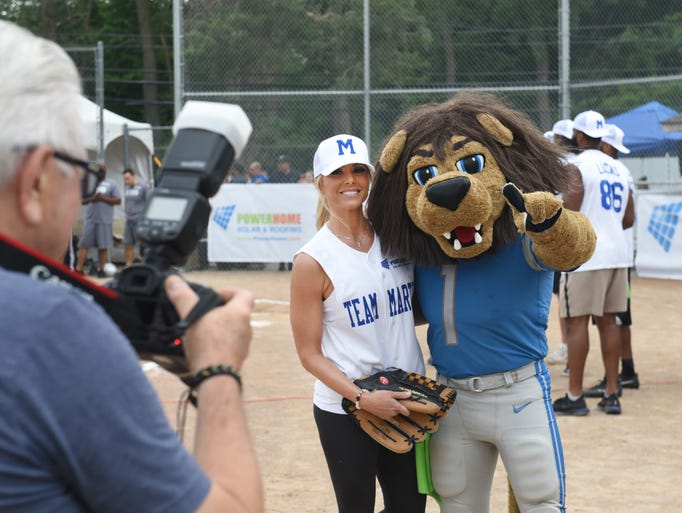 Detroit Lions mascot Rory poses with Fox 2 News co-anchor