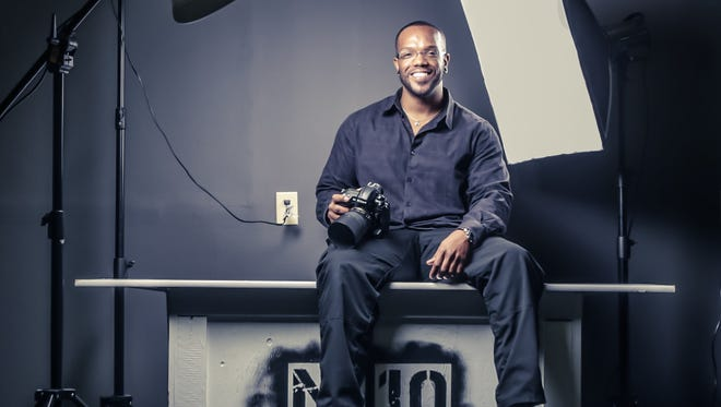 Dauss Miller, director of Help-Portrait Indianapolis 2014 and owner of Dauss Photo, poses for his own portrait in the M-10 Photo Studio. This year's worldwide Help-Portrait will take place Dec. 6, with the local event taking place at the Indianapolis Museum of Art.