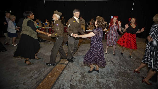 From left, Donna Spears, Rex Godfrey, Ron Itnyre and Alisa Clapp-Itnyre dance during Richmond Symphony Orchestra's 1940s-themed Boogie Woogie Ball in 2015.
