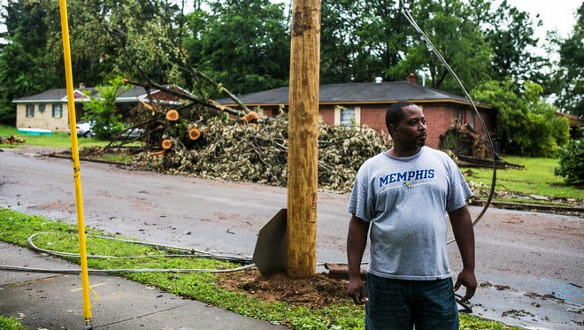 "June 4, 2017 - Jerome Palmer, 45, stands at the corner of Coventry Dr. and Durham Ave. as crews from the City of Memphis remove fallen trees and debris from the neighborhood in Frayser Sunday afternoon. Thousands of people were left without power as a result of last week's storm, including Palmer. He and his household were sans power for six days. Palmer says three of his vehicles were damaged as well as his roof. He also had to toss out perishable food from his refrigerator and deep freezer. ""It was basically a rough storm. It come through within, I know, a quick ten minutes at least,"" Palmer said. ""It was just a total mess out here."" Palmer, a City of Memphis employee, estimates the storm will cost him around $40,000 - $45,000 in damages. MLGW's outage map shows 6,500 customers are still without power as of noon Sunday."