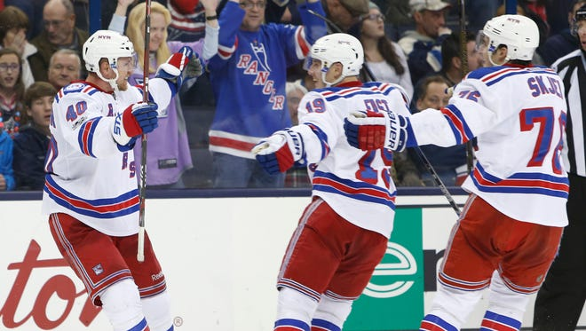 New York Rangers' Michael Grabner, left, of Austria, celebrates his game-winning goal against the Columbus Blue Jackets with teammates Jesper Fast, center, of Sweden, and Brady Skjei during the third period of an NHL hockey game Saturday, Jan. 7, 2017, in Columbus, Ohio. The Rangers beat the Blue Jackets 5-4.